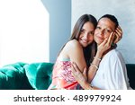 embrace of mother and daughter | Shutterstock . vector #489979924