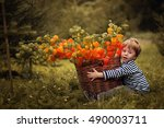 cute little boy in striped vest ... | Shutterstock . vector #490003711