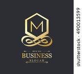 m letter logo  gold emblem ...   Shutterstock .eps vector #490013599