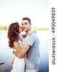 enamored a young woman kissing... | Shutterstock . vector #490049839