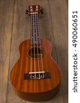 Small photo of Hawaiian ukulele guitar with four strings