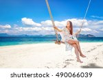 beautiful woman sitting on a... | Shutterstock . vector #490066039