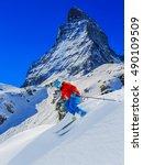 man skiing in deep fresh powder ... | Shutterstock . vector #490109509