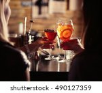 women toasting with cocktails... | Shutterstock . vector #490127359