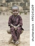 sitting boy outdoors   african... | Shutterstock . vector #490141609