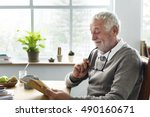 senior adult reading book... | Shutterstock . vector #490160671
