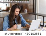 female blogger resting in a cafe | Shutterstock . vector #490163551