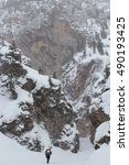 Small photo of Hiking Up Snowy Peak in Blizzard to Ice Climb in Colorado's Rocky Mountains of the Southwest while Drifts Accumulate on Steep Mountain Sides