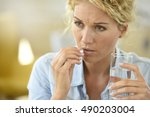 woman at work taking pill to... | Shutterstock . vector #490203004
