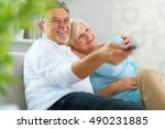 senior couple with remote... | Shutterstock . vector #490231885