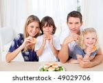 smiling family eating burgers... | Shutterstock . vector #49029706