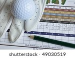 Close Up Of Golf Score Card...