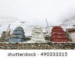 Three Stone Stupas Under...