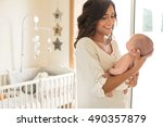 young mother holding her baby... | Shutterstock . vector #490357879