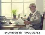 senior adult reading newspaper... | Shutterstock . vector #490390765