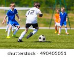 young boys playing soccer... | Shutterstock . vector #490405051