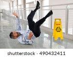 hispanic businessman falling on ... | Shutterstock . vector #490432411