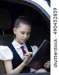 schoolgirl using digital tablet ... | Shutterstock . vector #490452859