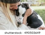 young woman with cute puppy... | Shutterstock . vector #490503649