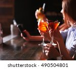 friends with cocktails in bar | Shutterstock . vector #490504801