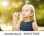 children girl blowing soap...   Shutterstock . vector #490517005