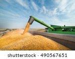 Pouring Corn Grain Into Tracto...