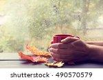 warming his hands red hot mug... | Shutterstock . vector #490570579