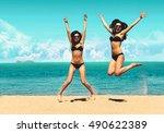 two attractive girls in bikinis ... | Shutterstock . vector #490622389