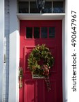 wreath on red door | Shutterstock . vector #490647967