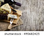 wine  cheese and grape on... | Shutterstock . vector #490682425