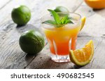 orange cocktail on rustic...   Shutterstock . vector #490682545