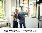 creative designers discusing in ...   Shutterstock . vector #490695241