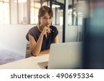 concentrated middle aged woman... | Shutterstock . vector #490695334