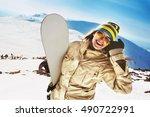 Happy Girl Snowboarder Posing...