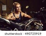 blond woman mechanic showing... | Shutterstock . vector #490725919