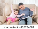 Little Girl And Father Are Reading Book Together - stock photo