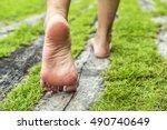 Woman's Feet Walking On The...
