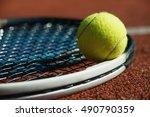 tennis racket and ball on court | Shutterstock . vector #490790359