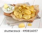 Potato Chips On A Parchment On...
