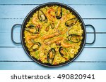 Spanish Paella On A Blue Woode...