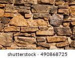 Small photo of Crushed stone wall detail - background and afterimage