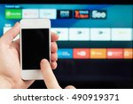 using smartphone as tv remote... | Shutterstock . vector #490919371