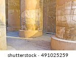 Small photo of The carved decors, preserved on columns and walls in pronaos of old Kom Ombo Temple in Egypt.