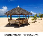 hut on the beach with turquoise ...