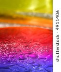 abstract multicolored background with water drops, focus is set in foreground - stock photo