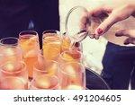 pour white wine into glasses ... | Shutterstock . vector #491204605