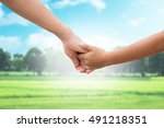 hand of parent and child on the ... | Shutterstock . vector #491218351