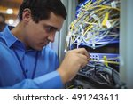 technician checking cables in a ... | Shutterstock . vector #491243611