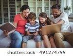 happy family sitting on sofa... | Shutterstock . vector #491274799