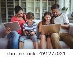 happy family sitting on sofa... | Shutterstock . vector #491275021
